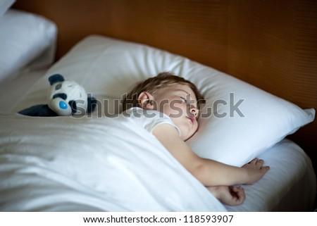 Adorable toddler taking a nap - stock photo