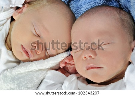 Adorable twin baby brother and sister - stock photo