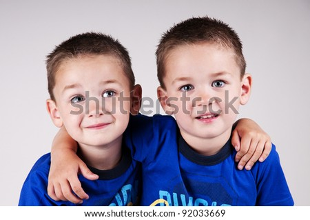 adorable twins in studio - stock photo