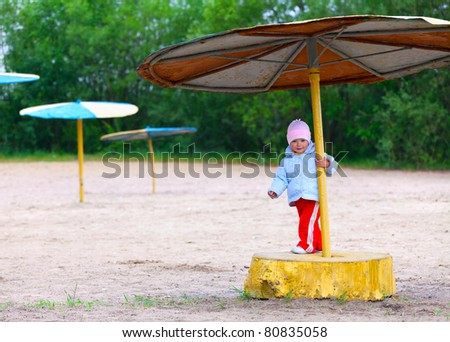 Adorable two-year girl walking on the autumn beach - stock photo