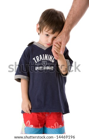 Adorable upset child hand with dad isolated on white background - stock photo