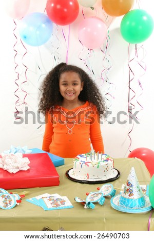 Adorable 8 year old African American girl at birthday party. - stock photo