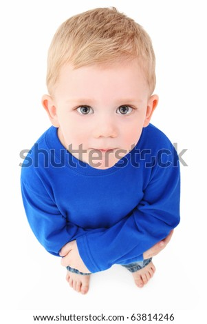 Adorable 2 year old boy looking up at camera over white background.  Top view. - stock photo