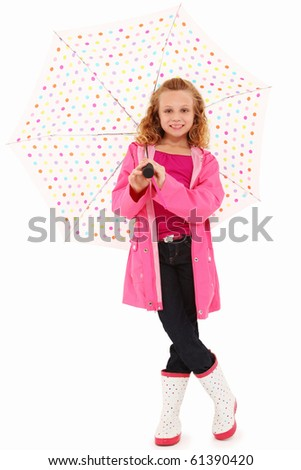 Adorable 7 year old girl in rain gear and pokadot umbrealla over white background. - stock photo