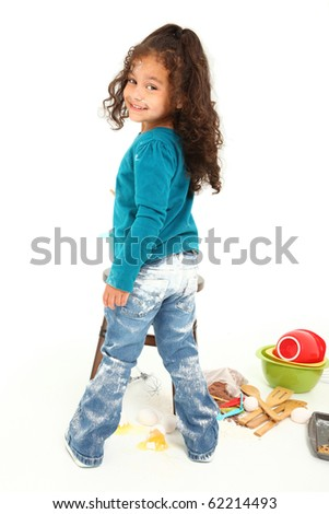 Adorable 3 year old Hispanic-African American girl, baking cookies over white background. - stock photo