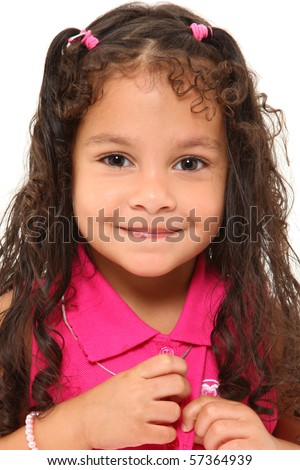 Adorable 3 year old mixed race girl buttoning her shirt over white background. - stock photo