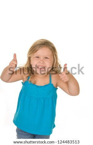 Adorable young blond girl doing thumbs up in the studio wearing casual clothing - stock photo