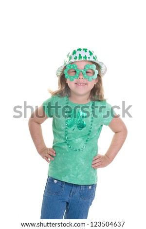Adorable young blond girl dressed for St. Patrick's Day - stock photo