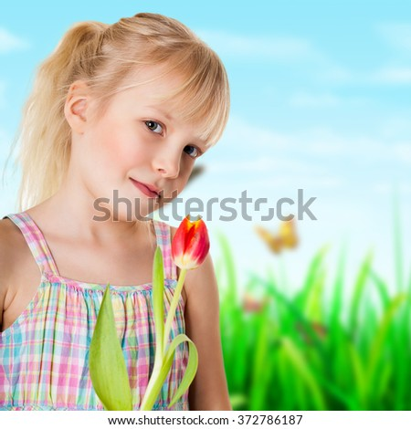 adorable young girl with a tulip - stock photo