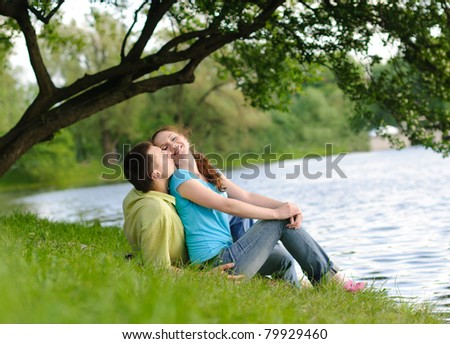 adorable young woman and man in the park - stock photo