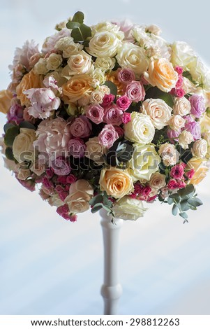 Adorning of wedding bouquet of fresh beautiful flowers of roses and peony white pink violet purple yellow lilac and orange colours in slim vase indoor, vertical picture - stock photo