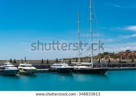 Adriano port on Spanish Majorca island with luxury motor yachts.  Expensive boats and sailing ships at mediterranean touristic destination in summer - stock photo