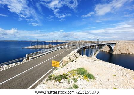 Adriatic sea and bridge to island of Pag in Croatia - stock photo