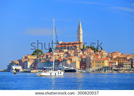 Adriatic sea and distant town with Venetian architecture, Rovinj, Croatia - stock photo