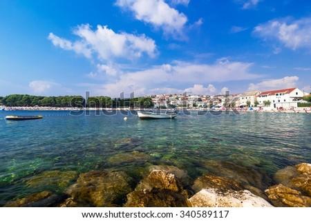 Adriatic sea, Croatia, Primosten landscape with boat - stock photo
