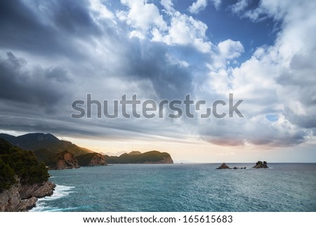 Adriatic Sea landscape with dramatic cloudy sky, Montenegro - stock photo
