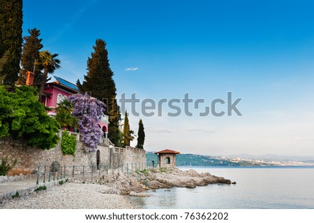 Adriatic Sea scenic view. Opatija town, popular tourist destination of Croatian coast. - stock photo