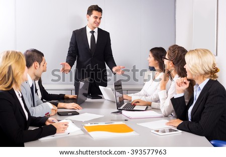 Adul business members of the multinational meetings in office. Focus on the man and right woman - stock photo