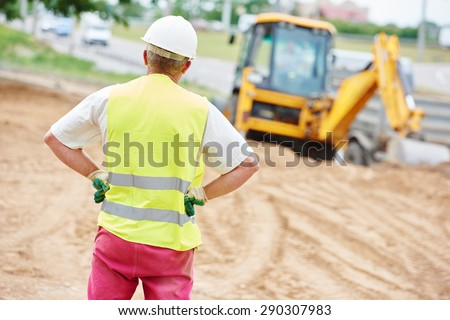 adult construction site manager worker at earthmoving roadwork  - stock photo