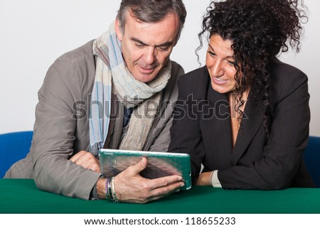 Adult Couple with Tablet PC - stock photo