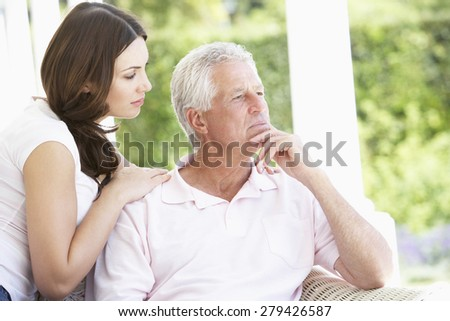 Adult Daughter Comforting Worried Father - stock photo