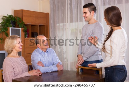 Adult daughter introducing her boyfriend to parents indoor  - stock photo