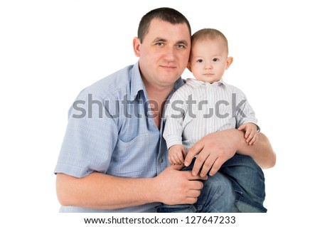 adult father hugs little son isolated on white background - stock photo