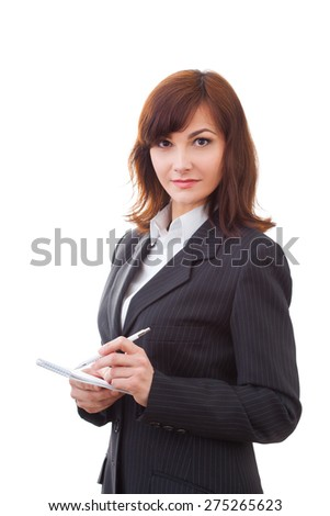 adult female in black suit makes some notes in notepad, isolated on white - stock photo