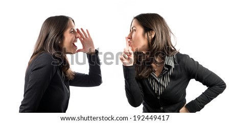 Adult girl making silence gesture and shouting over white background  - stock photo