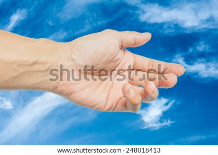 Adult hand reaching out towards the sky - stock photo