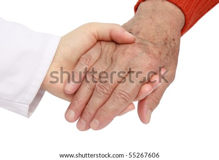Adult helping senior in hospital - stock photo