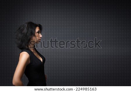 adult lady looking in a profile view an empty space - stock photo