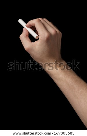 adult man hand to draw something with chalk, black background - stock photo