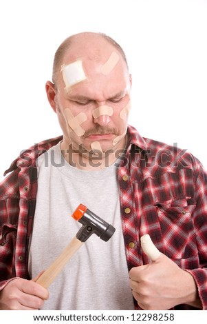 Adult man having hit his thumb with the hammer - stock photo
