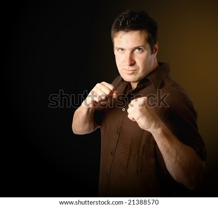 Adult man in punching pose - stock photo
