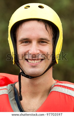 Adult man wearing typical water sport outfit - stock photo