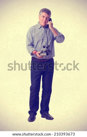 Adult man with a telephone - stock photo