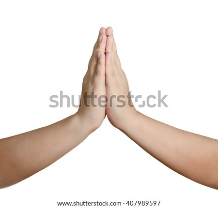 adult man with his hands placed together in prayer in front of an isolated white background. Male hands put together in a sign of praying closeup - stock photo