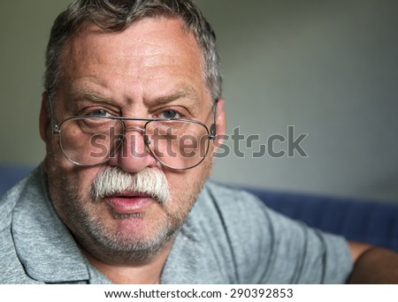 Adult mustached man with glasses - stock photo