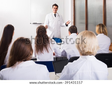 adult positive russian health-care workers during educational program in medical school - stock photo