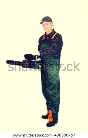 Adult sawyer with chainsaw - stock photo