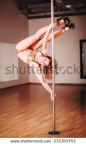 adult sexy young caucasian female poledancer - stock photo