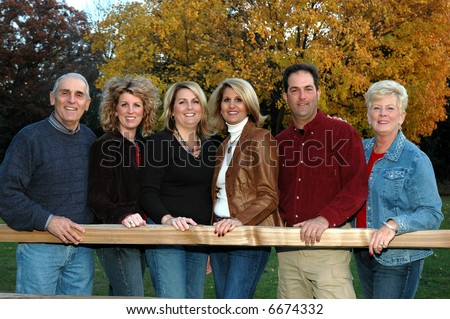 adult siblings with elderly parents - stock photo