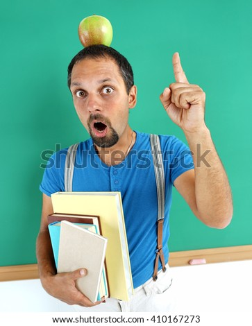 Adult student having good idea, pointing finger up and looking at camera. Refresh one's memory, creative concept with Back to school theme - stock photo