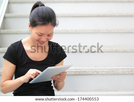 adult student use tablet pc in library  - stock photo