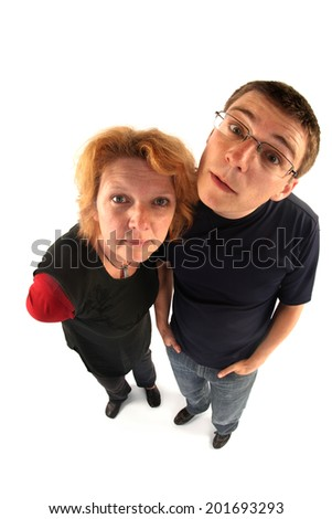 Adult woman and young man looking at you (fisheye lens) - stock photo