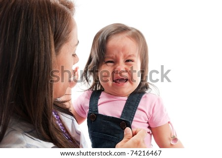Adult woman care an Asian girl crying - stock photo