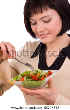 Adult woman holding plate with healthy salad. Portrait of young happy female eating salad - stock photo