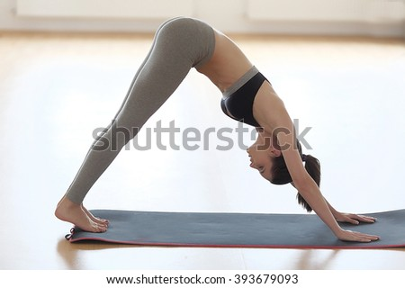 Adult woman in yoga position. - stock photo