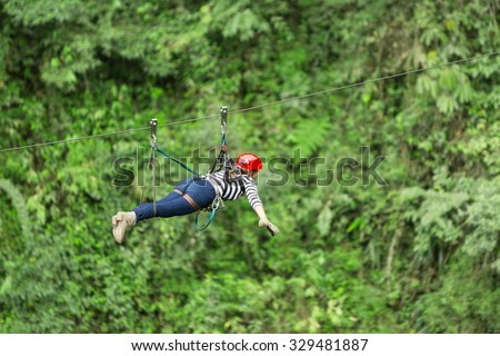 Adult Woman On Zip Line Ecuadorian Andes - stock photo